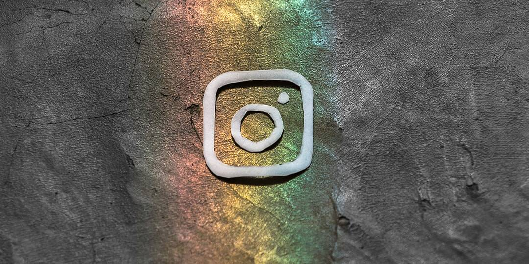 Instagram logo in rainbow on gray background