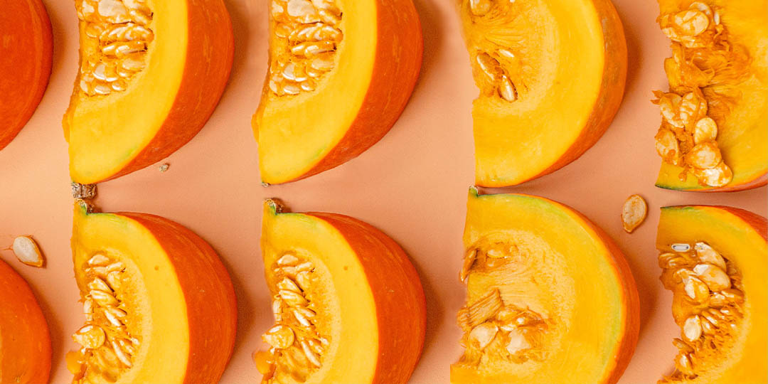 Pumpkin slices on orange background