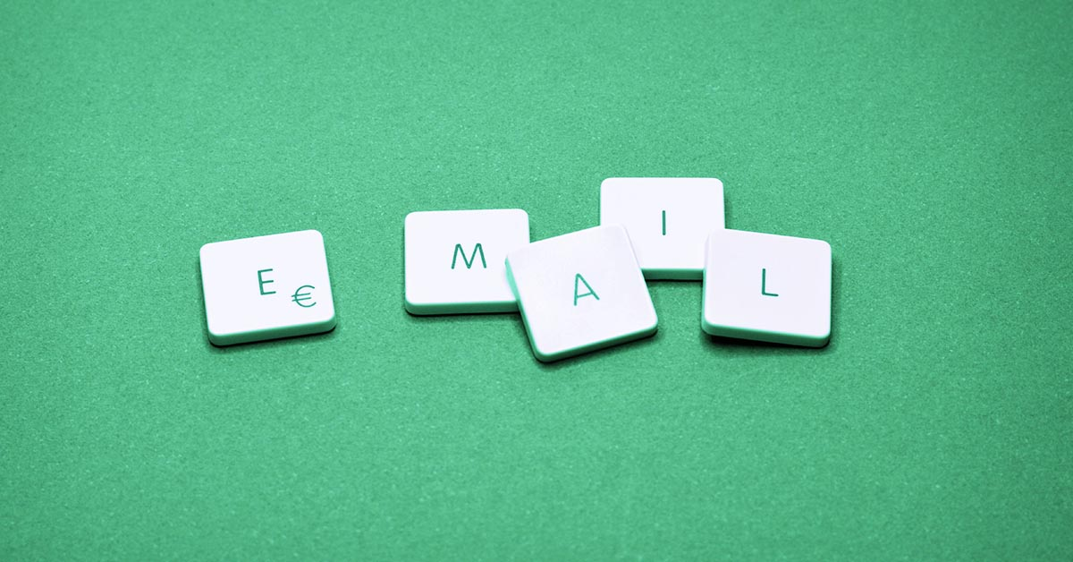Email letter tiles on green background