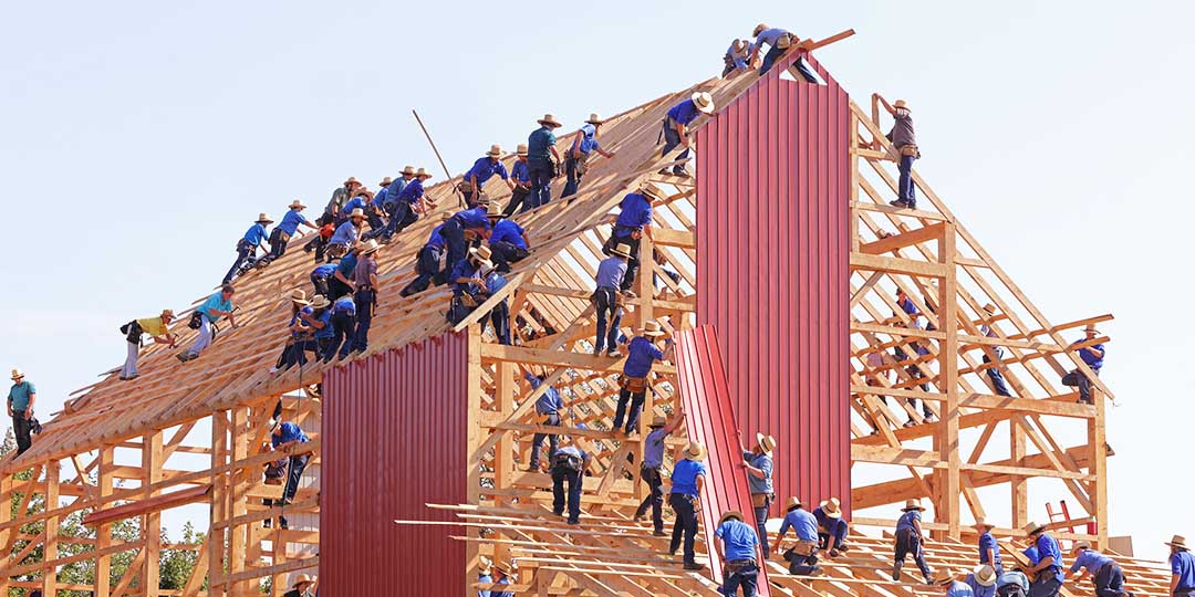 People constructing a building