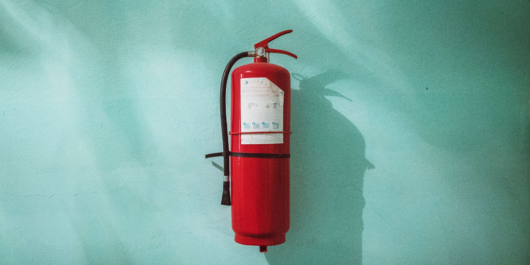 red fire extinguisher on blue background