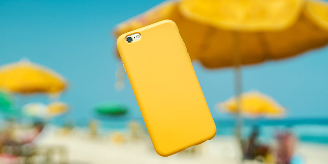yellow iphone and beach