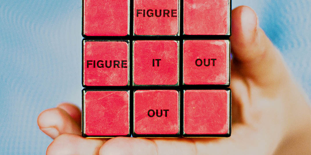 "Red Rubik's cube showing ""Figure it out"""
